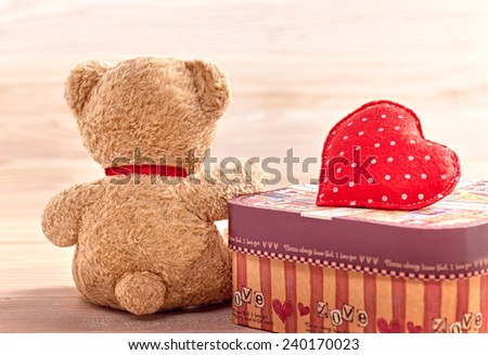 Valentines Day. Teddy Bear Loving with Heart Handmade and Gift box, Vintage. Retro Styled. Love concept on wooden background - stock photo