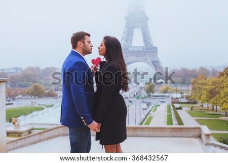 Valentines day travel destination, couple in love near Eiffel Tower, Paris, France - stock photo