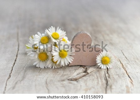 Valentines day. Valentines day flowers - daisy and heart on old wood.Valentines day. Valentines day.  Background Valentines Day. Valentines day ideas. Valentines day. Valentines day cards.   - stock photo