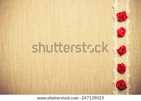 Valentines day, wedding, invitation or greeting card. Red decorative silk rose flowers, lace ribbon on linen cloth. Border frame. Retro style - stock photo