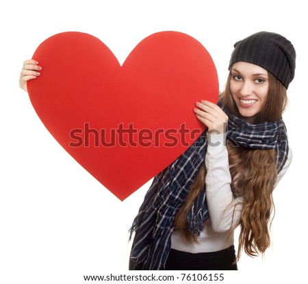 Valentines Day. Woman holding Valentines Day heart sign with copy space - stock photo