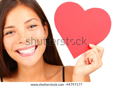 Valentines Day. Woman holding Valentines Day heart sign with copy space. Beautiful mixed race chinese / caucasian model isolated on white background. - stock photo