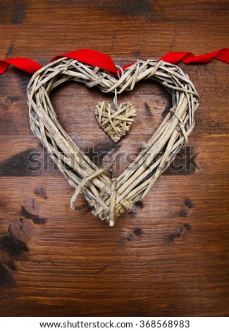 Valentines day wood heart and ribbon over wooden - stock photo