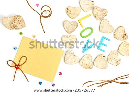 Valentines day. Word Love and Hearts made of bark on white background - stock photo