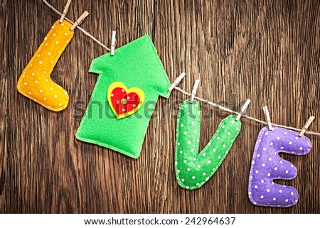 Valentines Day. Word Love dots, house Handmade, hanging on rope. Vintage style. Love concept on wooden background - stock photo