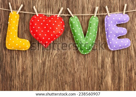 Valentines Day. Word Love, Heart Handmade, hanging on rope. Vintage dots style. Love concept on wooden background - stock photo