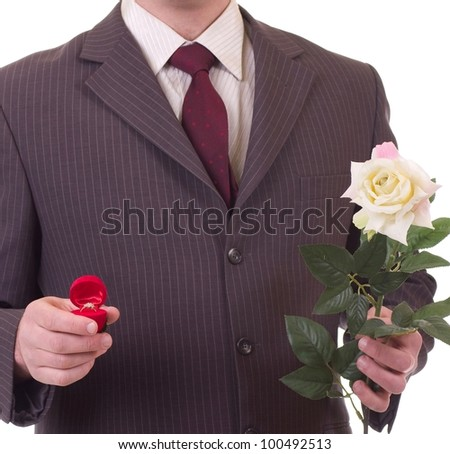 Valentines Man with flower and gift. Proposal scene - stock photo