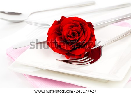 Valentines table setting with an gift box, to celebrate the holiday with a loved one - stock photo