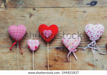 Valentines Vintage Handmade Hearts over Wooden Background on wooden table - stock photo