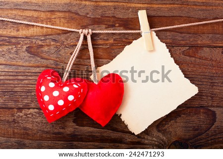 Valentines Vintage Handmade Hearts over Wooden Background. Valentine over Wood. Retro Styled Wallpaper. Valentines Day. Paper Tag labeling.  - stock photo