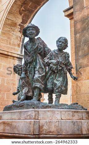 "VALETTA, MALTA - JANUARY 18 2015: Bronze group called ""Les Gavroches"" in park in Upper Barrakka Gardens - stock photo"
