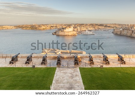 VALETTA, MALTA - JANUARY 18 2015: View to Fort Saint Angelo from Upper Barrakka Gardens over Saluting Battery, Valetta, Malta - stock photo