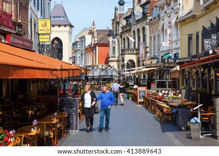 Valkenburg, Netherlands - April 11, 2016: city view with restaurants and unidentified people in the old town of Valkenburg. Valkenburg aan de Geul in province Limburg is a popular tourist destination - stock photo