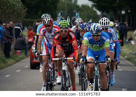 VALKENBURG, NETHERLANDS - SEPTEMBER 29 : Peleton of cyclists during the cycling world championship september 29,2012 in Valkenburg, The Netherlands - stock photo