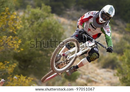 """VALL D'UIXO, SPAIN - MARCH 04: Daniel Miranda competes in the """"Nissan European Downhill Cup"""" on March 04, 2012, Vall d'Uixo, Spain - stock photo"""