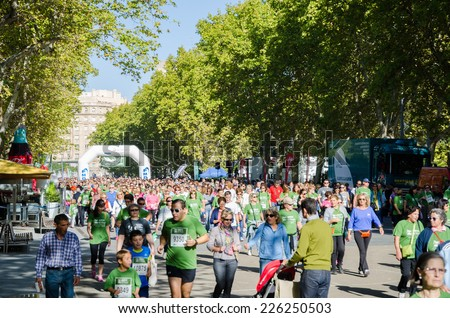 VALLADOLID, SPAIN - OCTOBER 27: marathon runner at Plaza Mayor, Valladolid. AECC Valladolid en marcha on October 27, 2014 in Valladolid, Spain - stock photo