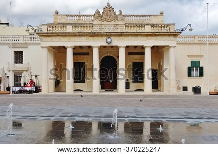 VALLETTA, MALTA --27 JANUARY 2015-- The Main Guard building, located in St George's square opposite the Grand Master's Palace in Valletta, was built in 1603 to house the palace guards. - stock photo