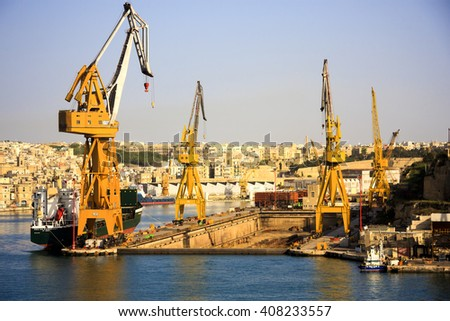 VALLETTA MALTA - MAY 20 2009:  Huge Ship yard cairns in Malta.  Valletta  has a deep sea port for shipping  and massive dry docks for ship yard works. - stock photo