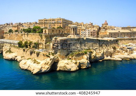 VALLETTA, MALTA - MAY 20 2009:  View to the medieval architecture in Valletta Grand Harbor.  More then 1,6 mil tourists is expected to visit Malta. Valletta is the capital city of Malta, - stock photo