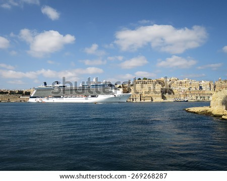 Valletta, OCT 12: The cruise chip Celebrity Equinox anchored off Valletta on Oct 12, 2014 in MALTA. Equinox is a Solstice-class cruise ship owned by Celebrity Cruises, entered service from 2009 - stock photo