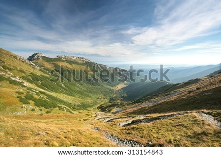 "Valley and the popular mountain ""Giewont"" in the Tatras. - stock photo"