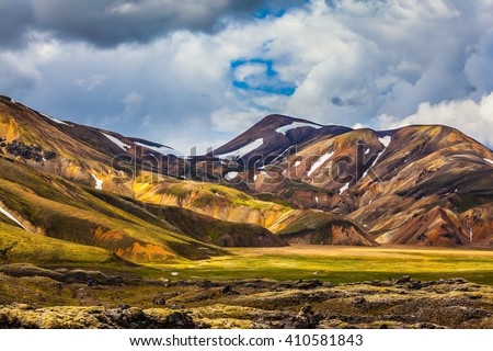 Valley National Park Landmannalaugar. On the gentle slopes of the mountains are snow fields and glaciers. Magnificent Iceland in the summer - stock photo