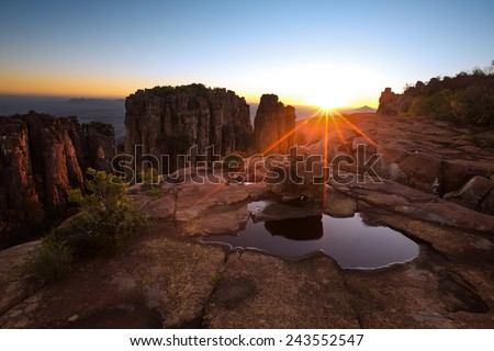 Valley of Desolation in Camdeboo National Park near Graaff-Reinet landscape with rocks and sunset - stock photo