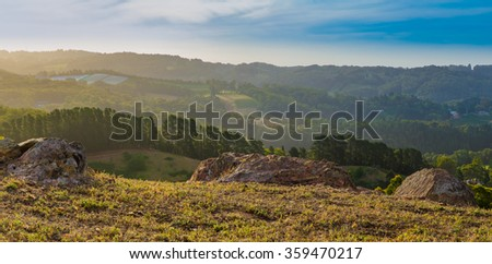 Valley view from rocky top of the hill late afternoon landscape - stock photo