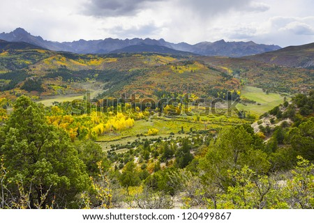valley with golden and green trees in colorado during fall at east Dallas Creek Ridgway looking at Mt Sneffels - stock photo