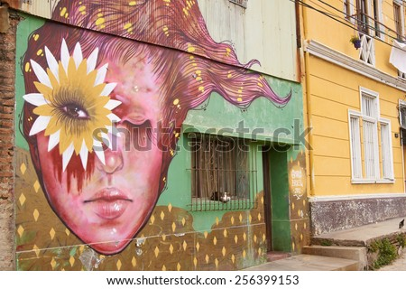 VALPARAISO, CHILE - JANUARY 19, 2015: Colourful murals decorating the walls of buildings in the historic port city of Valparaiso in Chile. - stock photo