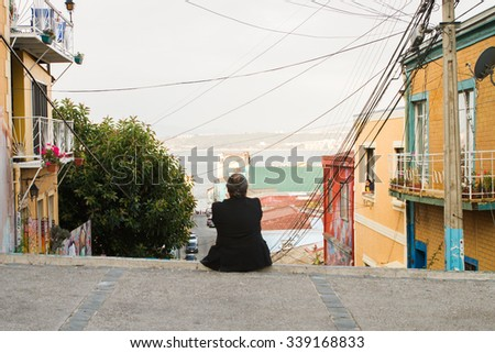 VALPARAISO - NOVEMBER 07: People on the streets in the districts of the protected UNESCO World Heritage Site of Valparaiso on November 7, 2015 in Valparaiso, Chile - stock photo