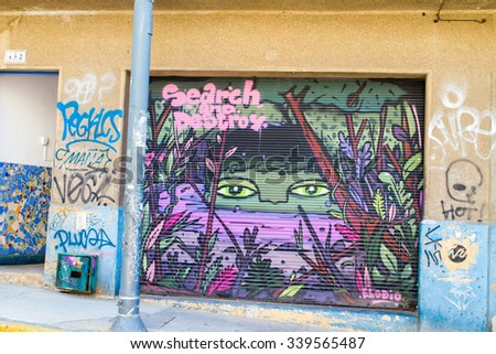 VALPARAISO - NOVEMBER 07: Street art in the districts of the protected UNESCO World Heritage Harbour Site of Valparaiso on November 7, 2015 in Valparaiso, Chile - stock photo