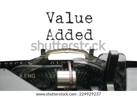 Value added on typewriter - stock photo