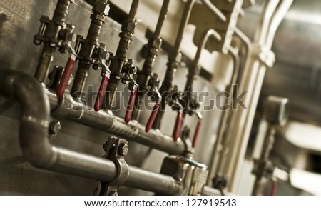 Valves in Vessel's ( Ship ) Engine Room Space - stock photo