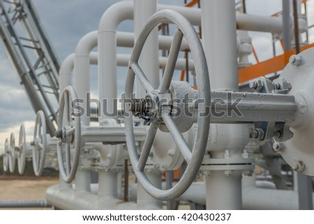 Valves on the pipe. Gas transit station - stock photo