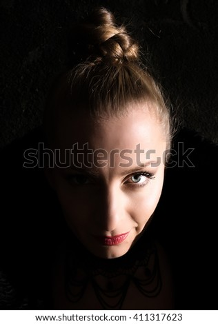 Vampire styled portrait of a adult woman. - stock photo