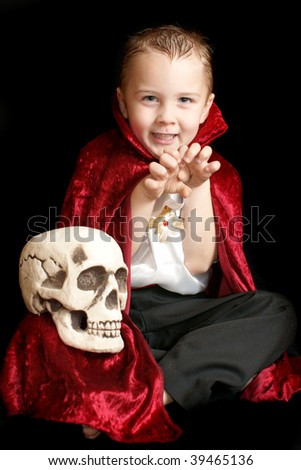 vampire with scull - stock photo