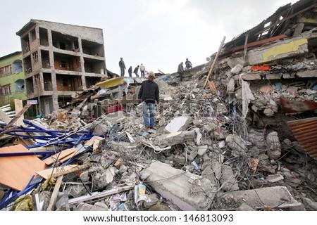 VAN, TURKEY - OCTOBER 25: Buildings ruined during the earthquake of Van-Ercis on October 25, 2011 in Van, Turkey. It is 604 killed and 4152 injured in Van-Ercis Earthquake. - stock photo
