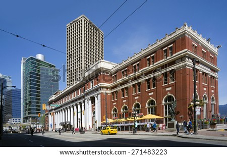 VANCOUVER - APRIL 19, 2015: Main transit terminus in downtown is Waterfront Station, built in 1914 by Canadian Pacific Railway. Building is designed in neoclassical style with symmetrical brick facade - stock photo