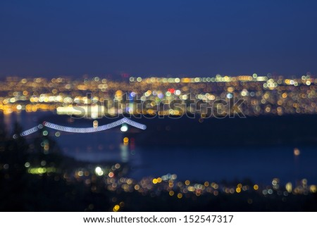 Vancouver BC Canada Cityscape with Stanley Park and Lions Gate Bridge at Evening Blue Hour Defocused Blurred Background - stock photo