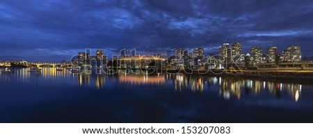 Vancouver BC Canada Downtown City Skyline by False Creek at Evening Blue Hour Panorama - stock photo