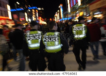 VANCOUVER, BC, CANADA - FEBRUARY 25: Police is present on every corner of every street in Vancouver during 2010 Olympic Games, February 25, 2010 in Vancouver, BC, Canada - stock photo