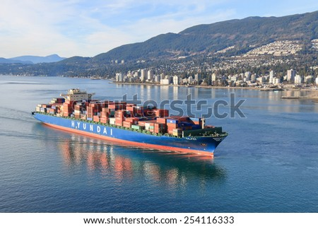 VANCOUVER, BC, CANADA - JANUARY 5, 2014: Container ship Hyundai Faith enters Vancouver Harbor on January 5, 2014. Port Metro Vancouver handles more than 2.5 million cargo containers annually. - stock photo