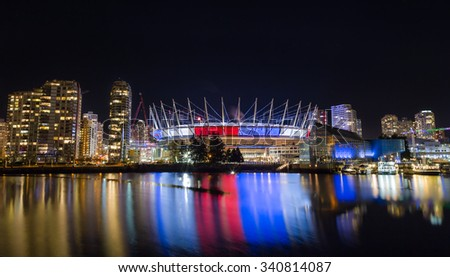 VANCOUVER, BC, CANADA - NOV 16,2015: BC Place, in False Creek, displaying the French tricolore as a show of support in the week following the attacks in Paris.  - stock photo