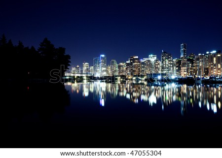 Vancouver BC evening skyline, Canada from Stanley Park - stock photo