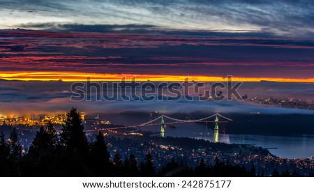 Vancouver, British Columbia at sunrise from the mountains of West Vancouver - stock photo