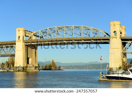 Vancouver Burrard Bridge is an Art Deco style bridge crossing False Creek between downtown Vancouver and Kitsilano, British Columbia, Canada. - stock photo