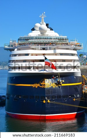 VANCOUVER, CA - JULY 28: Disney Wonder Nassau Cruise Ship at Canada Place Harbor on July 28, 2014 in Vancouver, Canada. Famous Vancouver main cruise ship terminal, it was built in 1927. - stock photo