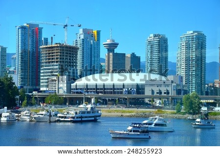 VANCOUVER, CA- JULY 28: Downtown Vancouver and Lifestyle on July 28, 2014 in Vancouver, CA Vancouver has prominent buildings in a variety of styles by many famous architects. - stock photo