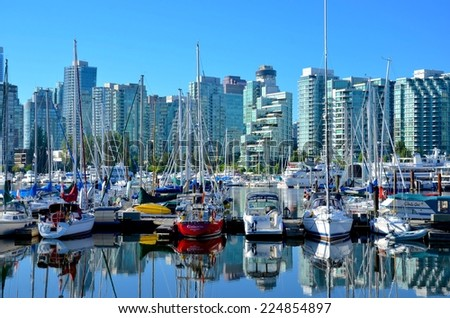 VANCOUVER, CA - JULY 27: Downtown Vancouver Waterfront Architecture, and Lifestyle on July 27, 2014 in Vancouver, CA. Vancouver has prominent buildings in a variety of styles by many famous architects - stock photo